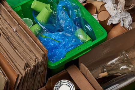 sorted trash of cardboard, glass bottles, polyethylene, plastic and paper cups