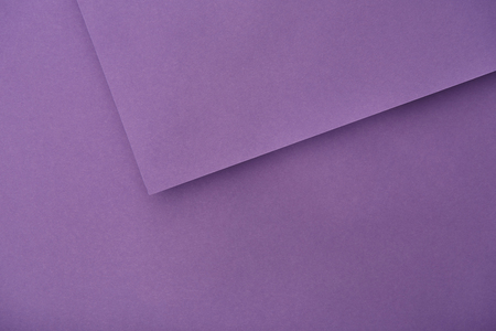 top view of violet paper sheets with copy space