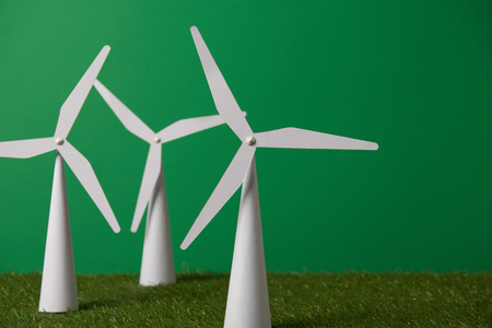 windmill models on grass and green background