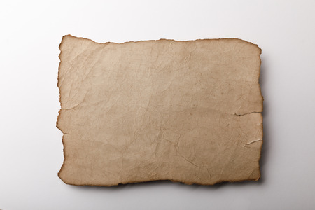 top view of old parchment sheet lying on white background Stock Photo