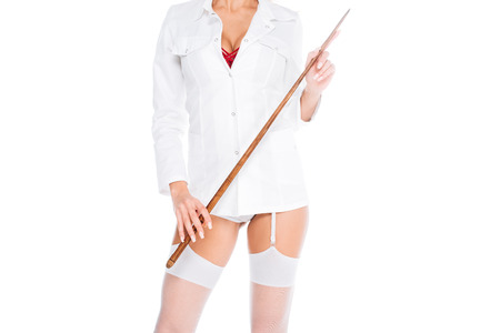 cropped view of nurse in short coat, stockings holding pointer isolated on white Фото со стока
