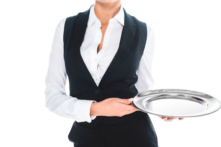 cropped view of waitress in black uniform holding tray isolated on white Stockfoto