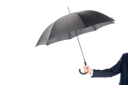 cropped view of businessman holding black umbrella isolated on white