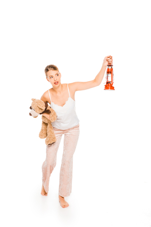 girl in pyjamas holding teddy bear and lantern isolated on white Stock fotó - 119061693