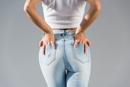 Cropped view of sexy girl in blue jeans