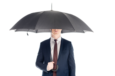 stylish businessman with obscure face holding umbrella isolated on white