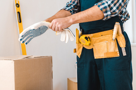 cropped view of handyman wearing glove on hand Stockfoto