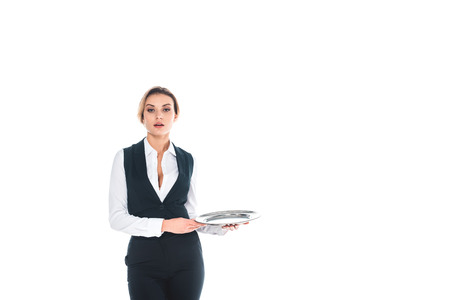 attractive blonde waitress in black uniform holding tray isolated on white
