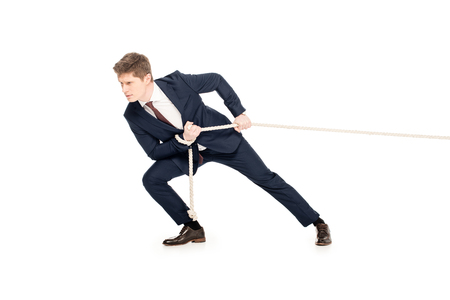 young businessman in suit pulling rope isolated on white