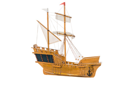 wooden ship model floating in air isolated on white