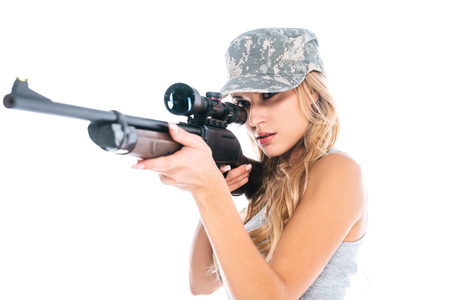 attractive militarywoman in camouflage cap with rifle isolated on white Imagens