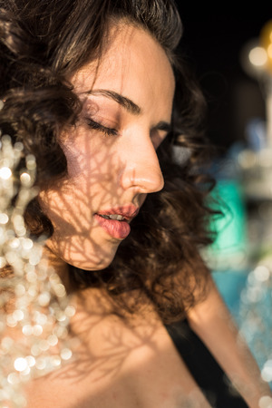 Curly relaxed woman with closed eyes on blur background Archivio Fotografico - 119125362