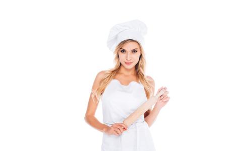 attraente, cuoco, donna, in, uniforme, presa a terra, mattarello, isolato, su, white Archivio Fotografico