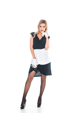 blonde housemaid in black uniform with apron on white background