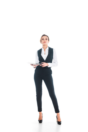 waitress in black uniform standing and holding tray on white background Stockfoto
