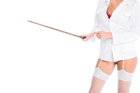 cropped view of nurse in short coat, stockings and red underwear holding pointer isolated on white Фото со стока