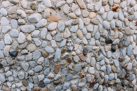multicolored handwork textured stone wall, barcelona, spain 写真素材