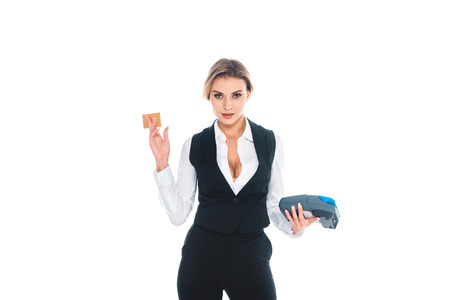 blonde attractive waitress in black uniform standing with credit card and  terminal isolated on white