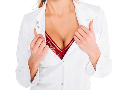 cropped view of nurse in coat showing red underwear isolated on white