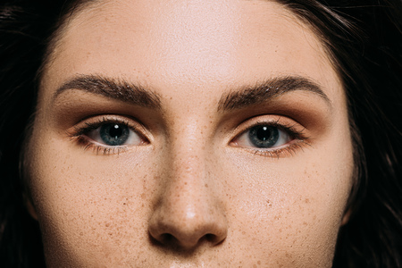 close up of attractive girl with freckles on face