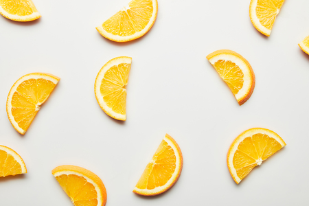 Top view of juicy orange slices on white background Stock Photo