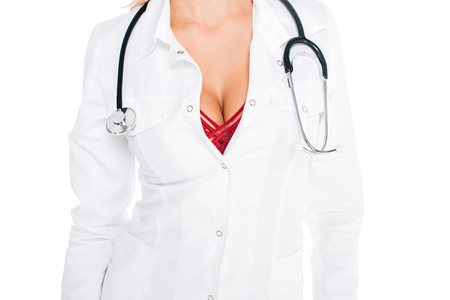 cropped view of nurse in coat, red underwear with stethoscope isolated on white Stockfoto - 118996871