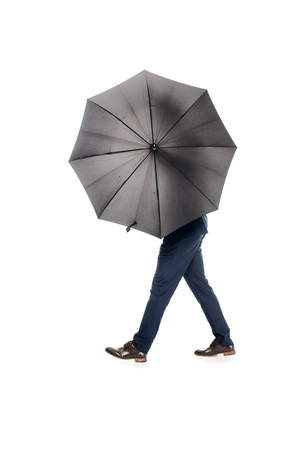 businessman posing with black umbrella isolated on white