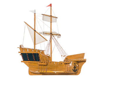 vintage ship model floating in air isolated on white with copy space