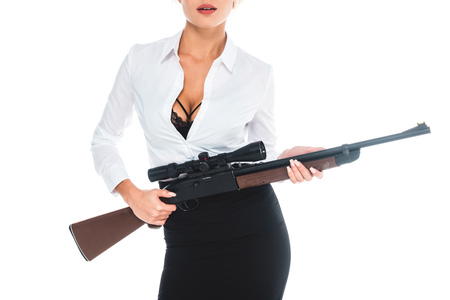 cropped view of teacher in blous with open neckline and skirt holding rifle isolated on white