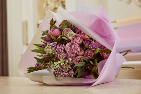 bouquet of tulips, peonies and lilac on table