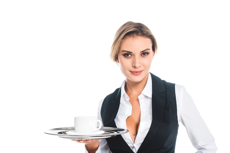 blonde attractive waitress in uniform holding tray with cup and saucer isolated on white