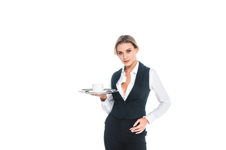 blonde waitress in black uniform holding tray with cup and saucer isolated on white