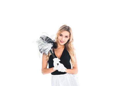 blonde housemaid in black uniform and gloves with broom isolated on white Stock Photo