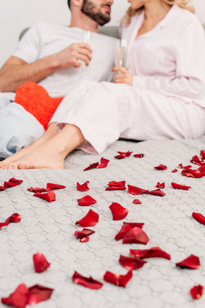 Partial view of couple celebrating valentines day in bed