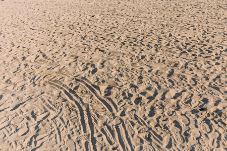beach sand with different traces, barcelona, spain