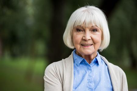 smiling senior woman in blue polka dot blouse