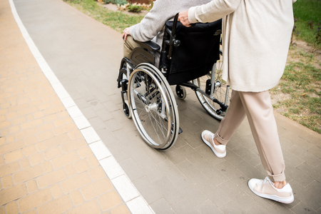 cropped view of senior woman with husband in wheelchair Stok Fotoğraf - 119522051