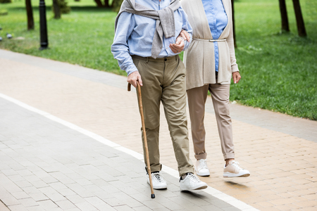 cropped view of senior couple walking in park Stok Fotoğraf - 119522059
