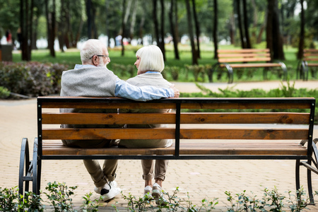 senior couple sitting on wooden bench in park Stok Fotoğraf - 119522083