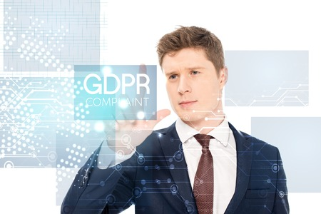 successful businessman in suit pointing with finger at gdpr compliant illustration on white background 版權商用圖片