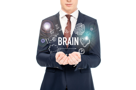 cropped view of businessman in suit with outstretched hands and brain lettering and icons above isolated on white