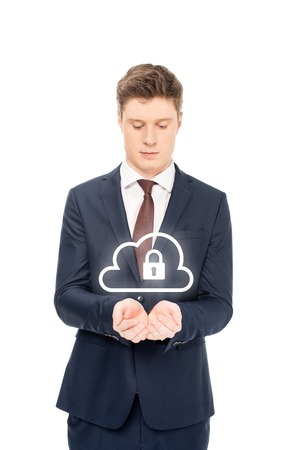businessman in suit looking at outstretched hands with internet security icons above isolated on white