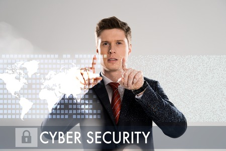 confident businessman in suit pointing with fingers at cyber security illustration in front