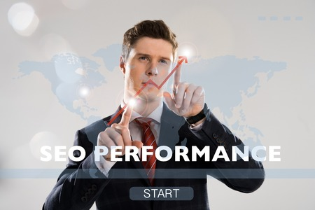 handsome businessman in suit pointing with fingers at cyber security illustration in front