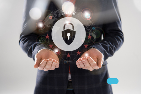 cropped view of businessman in suit with outstretched hands and gdpr letters and lock illustration in front