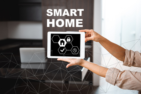 selective focus of digital tablet with smart home icons illustration in female hands 版權商用圖片