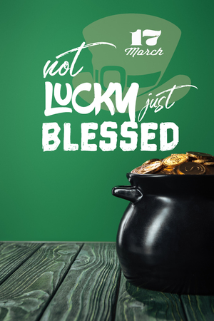 golden coins in pot with not lucky just blessed lettering on green background Stok Fotoğraf - 119529121