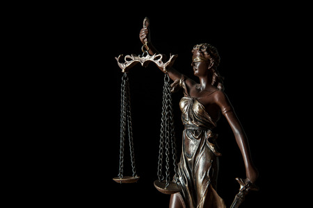 close up of bronze statuette with scales of justice isolated on black Stok Fotoğraf