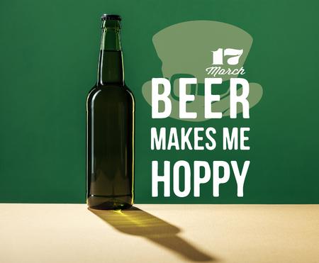 glass beer bottle near beer makes me hoppy lettering on green background