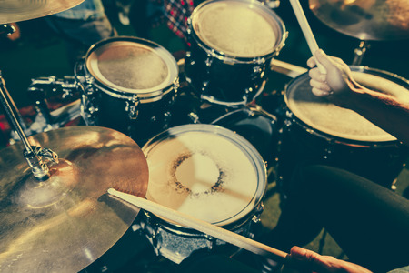 cropped view of drummer holding drum sticks while playing drums Stok Fotoğraf